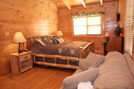 second floor king bedroom with sleeper sofa at starry starry night a 2 bedroom cabin rental located in pigeon forge