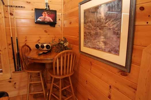 table in game room at starry starry night a 2 bedroom cabin rental located in pigeon forge