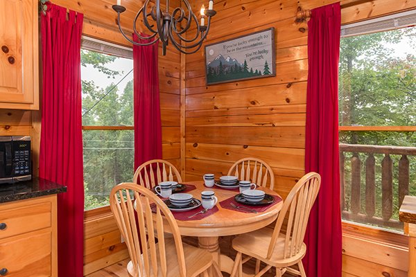 Dining room with seating for four at Bear View Lodge, a 2-bedroom cabin rental located in Gatlinburg