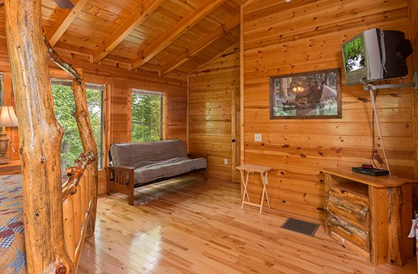 Futon in the loft bedroom at Bear View Lodge, a 2-bedroom cabin rental located in Gatlinburg