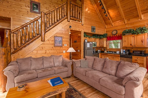 Two couches in the living room space at Bear View Lodge, a 2-bedroom cabin rental located in Gatlinburg