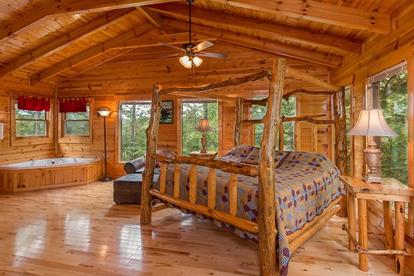 Four post log bed in the loft at Bear View Lodge, a 2-bedroom cabin rental located in Gatlinburg