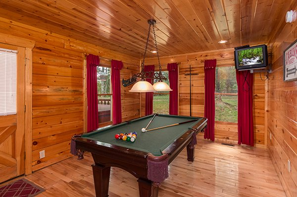 Green felted pool table at Bear View Lodge, a 2-bedroom cabin rental located in Gatlinburg