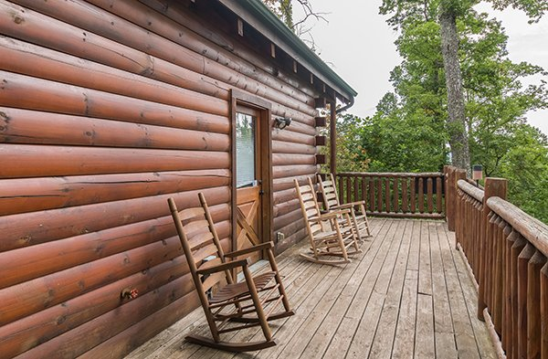 Three rocking chairs on the deck at Bear View Lodge, a 2-bedroom cabin rental located in Gatlinburg