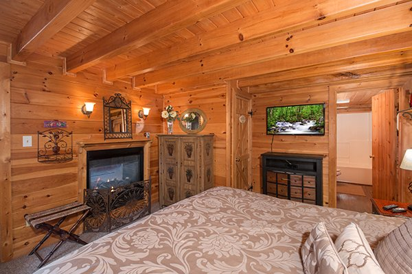 bedroom fireplace next to storage at all that jazz a 1 bedroom cabin rental located in pigeon forge