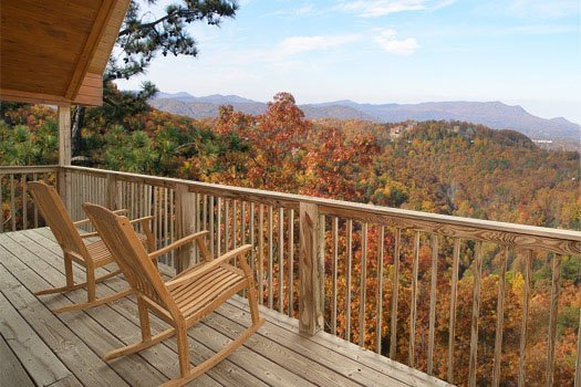 deck rockers facing the incredible smoky mountain views at all that jazz a 1 bedroom cabin rental located in pigeon forge
