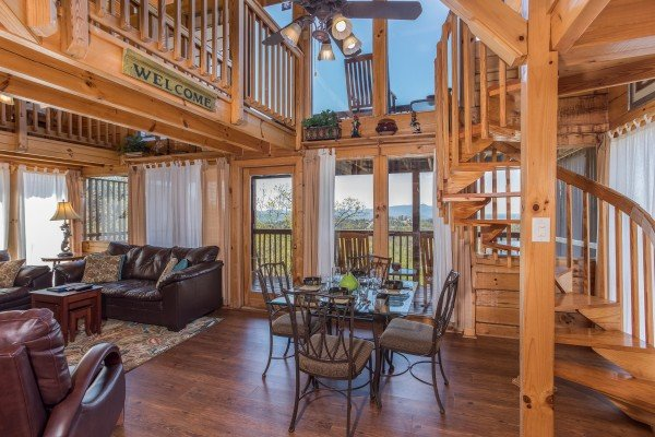 dining room with seating for four and a view at all that jazz a 1 bedroom cabin rental located in pigeon forge
