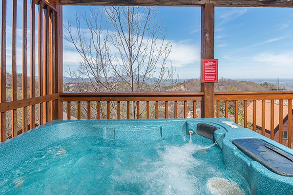 view from the hot tub on a covered deck at all that jazz a 1 bedroom cabin rental located in pigeon forge