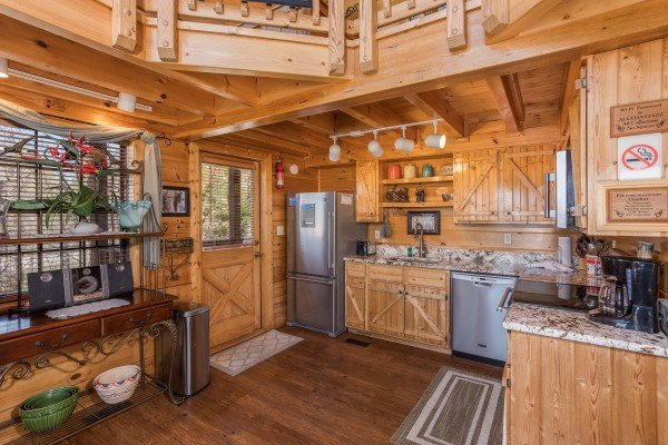 kitchen with stainless steel appliances at all that jazz a 1 bedroom cabin rental located in pigeon forge