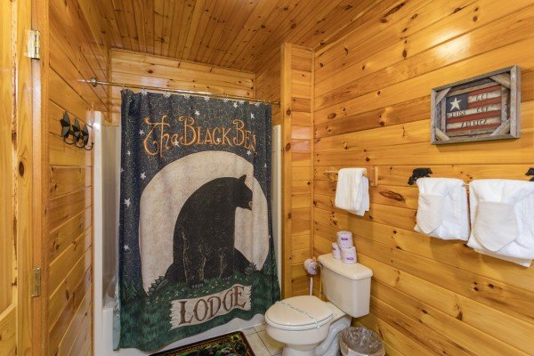 Bathroom with black bear decor at Bear Country, a 3-bedroom cabin rental located in Pigeon Forge