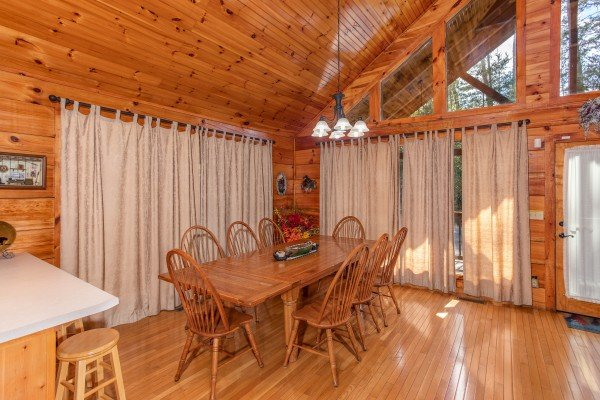 Dining room with seating for eight at Bear Country, a 3-bedroom cabin rental located in Pigeon Forge