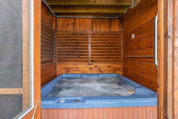 Enclosed hot tub for privacy at Bear Country, a 3-bedroom cabin rental located in Pigeon Forge