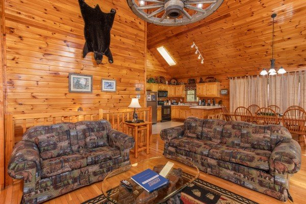 Couch and loveseat in the living room at Bear Country, a 3-bedroom cabin rental located in Pigeon Forge