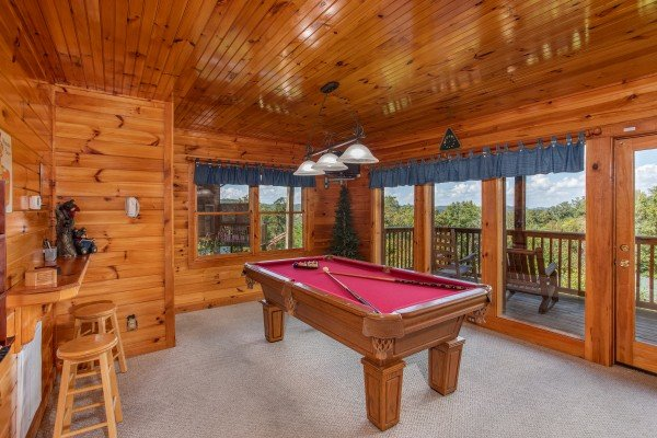Red felted pool table at Bear Country, a 3-bedroom cabin rental located in Pigeon Forge