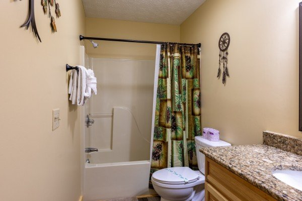 Bathroom with a tub and shower at Le Bear Chalet, a 7 bedroom cabin rental located in Gatlinburg
