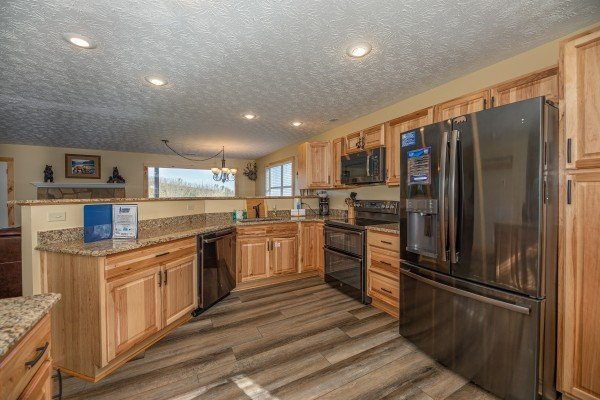Kitchen with stainless appliances at Le Bear Chalet, a 7 bedroom cabin rental located in Gatlinburg