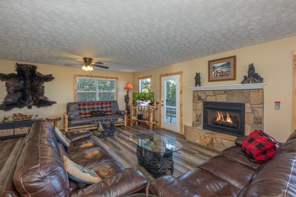 Living room with fireplace at Le Bear Chalet, a 7 bedroom cabin rental located in Gatlinburg