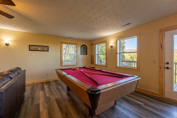 Red felt pool table at Le Bear Chalet, a 7 bedroom cabin rental located in Gatlinburg