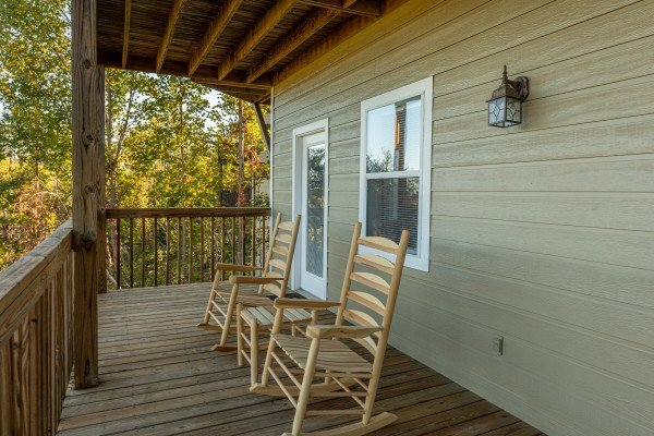 Rocking chairs on a deck at Le Bear Chalet, a 7 bedroom cabin rental located in Gatlinburg