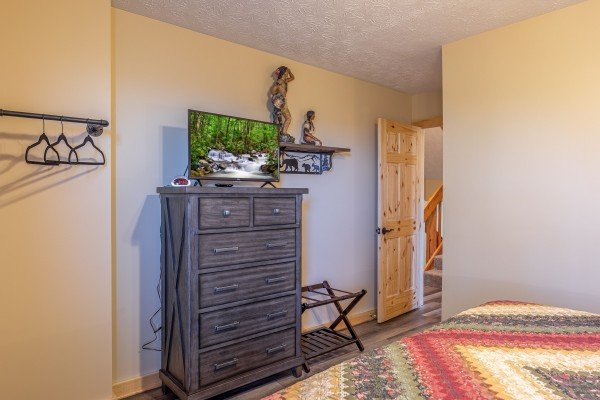 Dresser and TV in a bedroom at Le Bear Chalet, a 7 bedroom cabin rental located in Gatlinburg