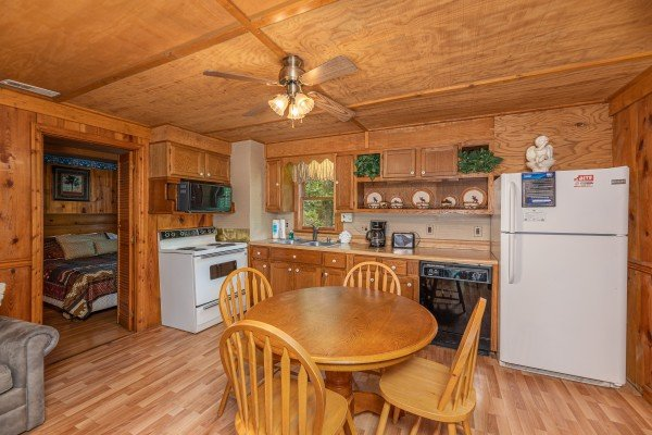 Dining room and kitchen at Heavenly Hideaway, a 2-bedroom cabin rental located in Gatlinburg