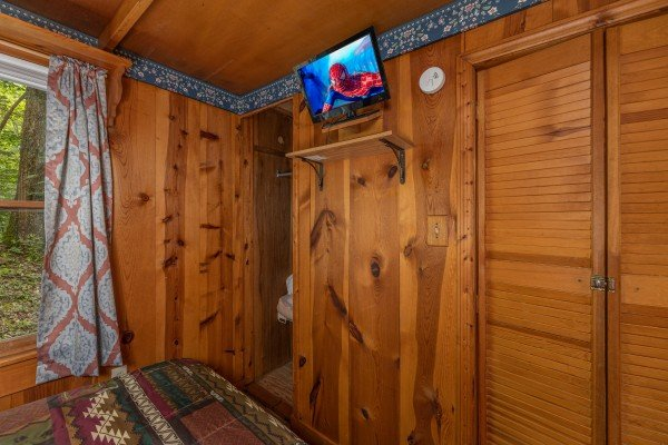 TV and closet in a bedroom at Heavenly Hideaway, a 2-bedroom cabin rental located in Gatlinburg