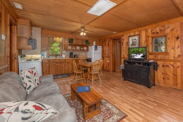 Living, dining, and kitchen space at Heavenly Hideaway, a 2-bedroom cabin rental located in Gatlinburg