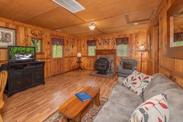 Living room with fireplace and TV at Heavenly Hideaway, a 2-bedroom cabin rental located in Gatlinburg