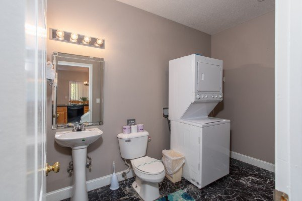 Bathroom with a laundry facility at Into the Woods, a 3 bedroom cabin rental located in Pigeon Forge