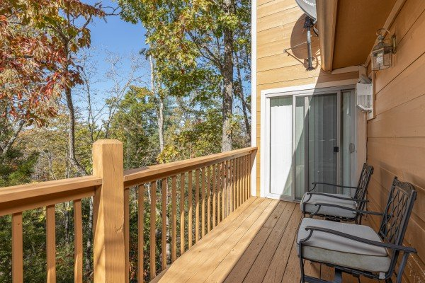 Deck with padded chairs at Into the Woods, a 3 bedroom cabin rental located in Pigeon Forge