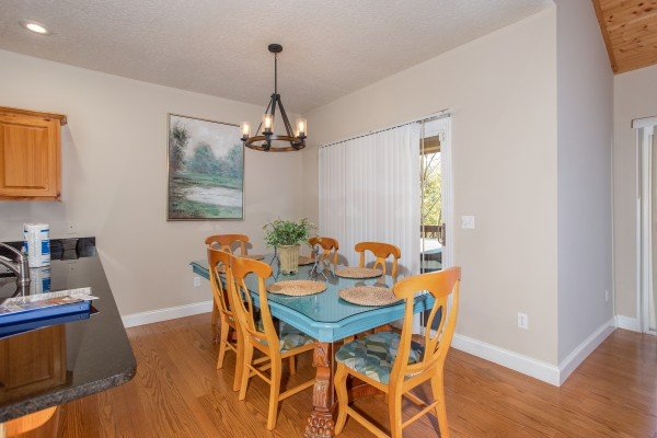 Dining table with seating for six at Into the Woods, a 3 bedroom cabin rental located in Pigeon Forge