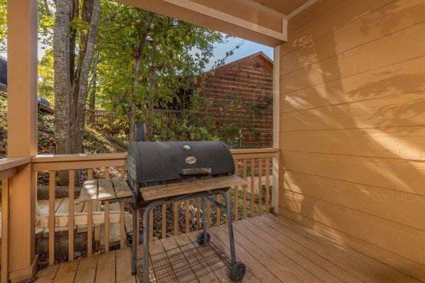 Grill on the covered deck at Into the Woods, a 3 bedroom cabin rental located in Pigeon Forge