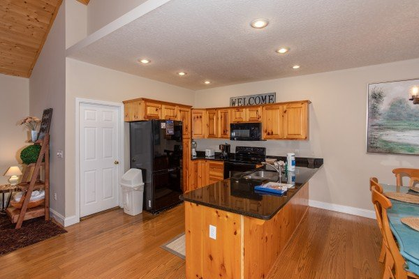 Kitchen with black appliances at Into the Woods, a 3 bedroom cabin rental located in Pigeon Forge