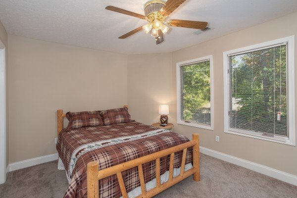 Bedroom with a queen log bed at Into the Woods, a 3 bedroom cabin rental located in Pigeon Forge