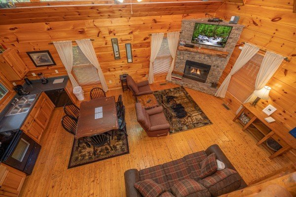 Looking down at the dining and living spaces at Firefly Ridge, a 2 bedroom cabin rental located in Pigeon Forge