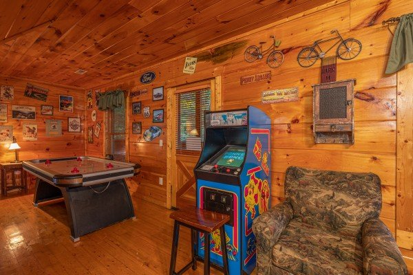 Air hockey and arcade game in the game room at Firefly Ridge, a 2 bedroom cabin rental located in Pigeon Forge