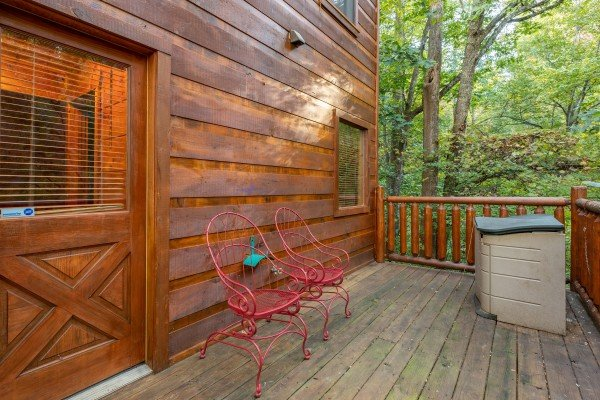 Two seats on a deck at Firefly Ridge, a 2 bedroom cabin rental located in Pigeon Forge