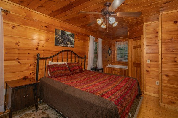 Bedroom with a king bed and jacuzzi at Firefly Ridge, a 2 bedroom cabin rental located in Pigeon Forge
