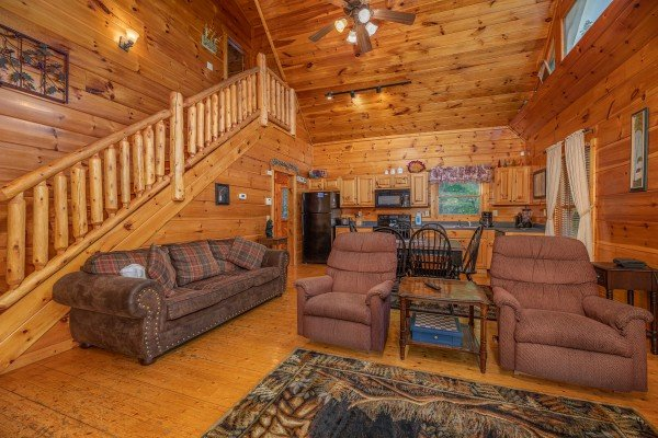 Two recliners and a sofa in the living room at Firefly Ridge, a 2 bedroom cabin rental located in Pigeon Forge