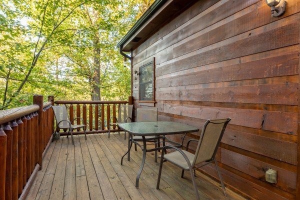 Outdoor dining on the deck at Firefly Ridge, a 2 bedroom cabin rental located in Pigeon Forge