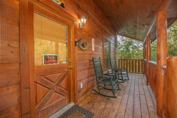 Rocking chairs on a covered deck at Firefly Ridge, a 2 bedroom cabin rental located in Pigeon Forge