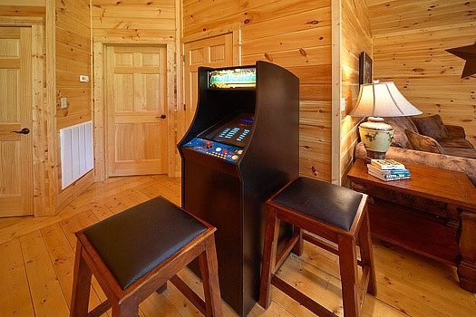 arcade console in game room at cozy creek a 3 bedroom cabin rental located in pigeon forge
