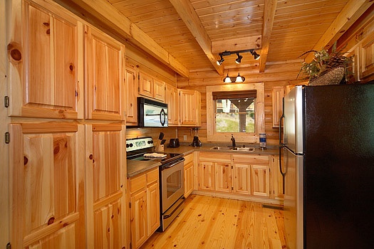 kitchen with stainless appliances at cozy creek a 3 bedroom cabin rental located in pigeon forge