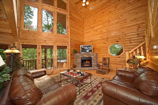 living room with fireplace at cozy creek a 3 bedroom cabin rental located in pigeon forge