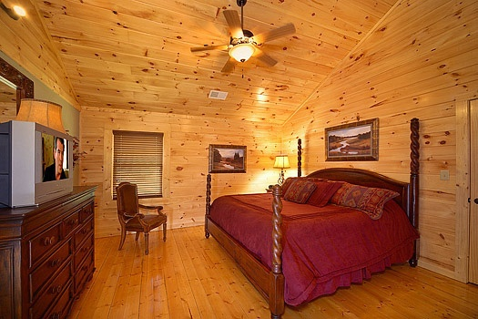 second floor bedroom with king sized bed at cozy creek a 3 bedroom cabin rental located in pigeon forge