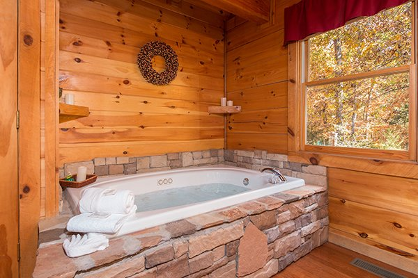 Jacuzzi tub at Bear Hug Hideaway, a 1-bedroom cabin rental located in Pigeon Forge