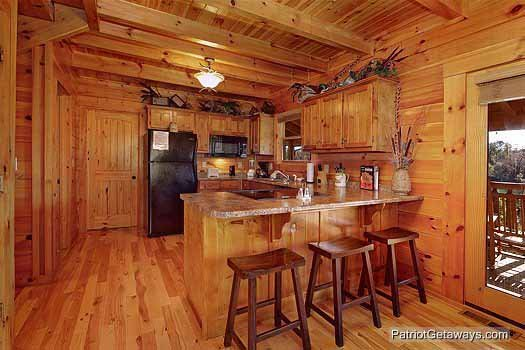 Breakfast bar with seating for three in kitchen at Logged Out, a 3 bedroom cabin rental located in Pigeon Forge