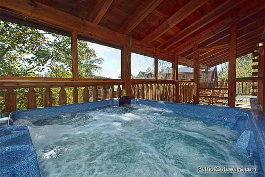 Hot tub on deck at Logged Out, a 3 bedroom cabin rental located in Pigeon Forge