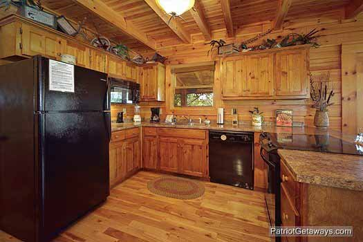 Kitchen with black appliances at Logged Out, a 3 bedroom cabin rental located in Pigeon Forge