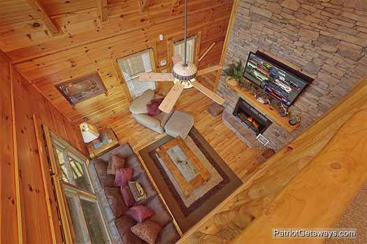 Living room view from the loft at Logged Out, a 3 bedroom cabin rental located in Pigeon Forge